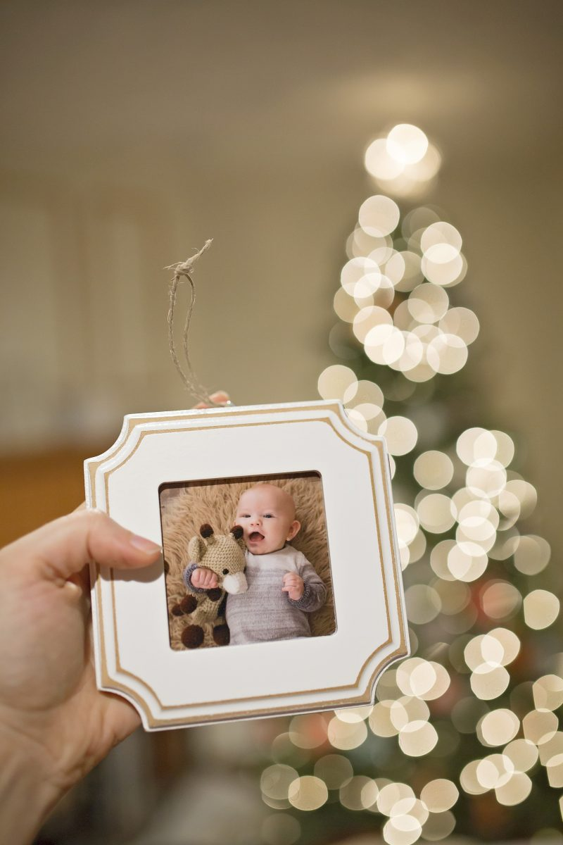 a framed photograph Christmas ornament of a four-month-old baby