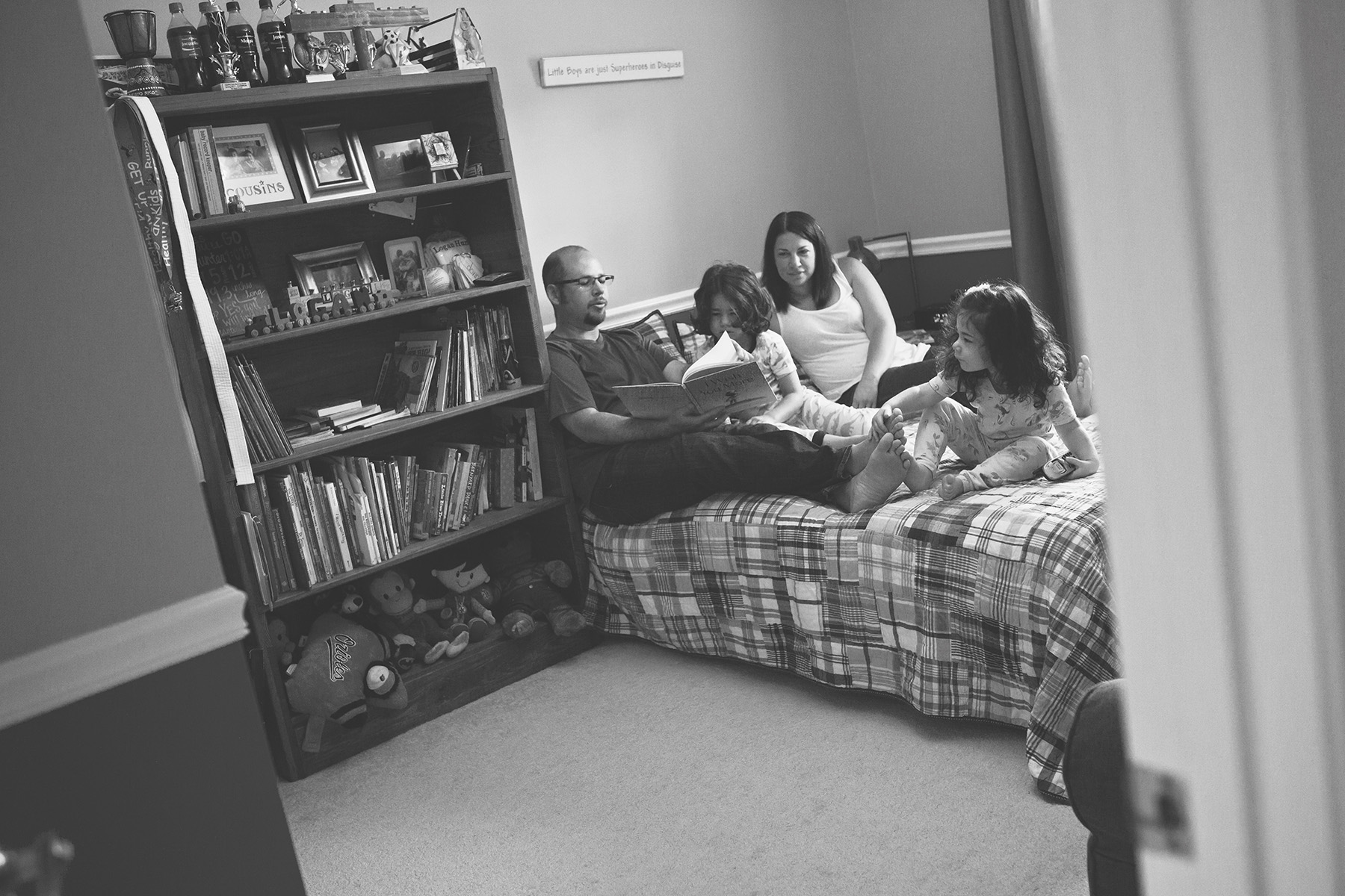 family reading on bed